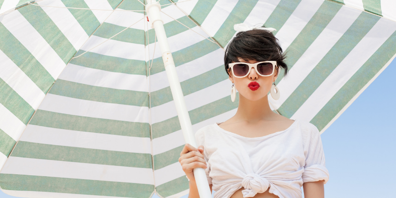 Woman with shade umbrella